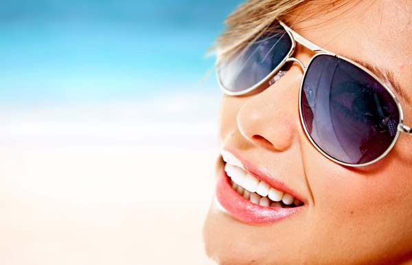 Beautiful woman wearing sunglasses on a summery day
